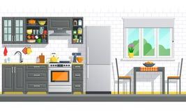 Muebles de la cocina con los dispositivos en una pared de ladrillo blanca Imágenes de archivo libres de regalías