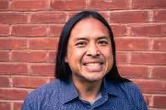 Mueca asiática feliz del hombre Fotografía de archivo libre de regalías