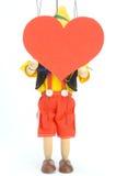 Muñeca y corazón Foto de archivo libre de regalías