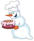Muñeco de nieve con una torta Imagen de archivo libre de regalías