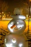 Muñeco de nieve de la pesadilla por noche Imagen de archivo libre de regalías
