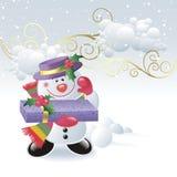 Muñeco de nieve lindo con el rectángulo de regalo Foto de archivo libre de regalías