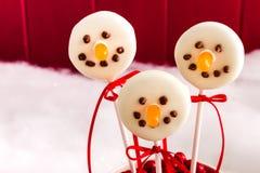 Muñecos de nieve y estallidos de la torta del reno Fotografía de archivo libre de regalías