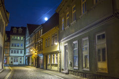 Muehlhausen by night with view. Road in Muehlhausen by night with view to old city gate Royalty Free Stock Photography