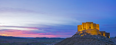 Muela castle at night, located in the town of Consuegra Stock Photos