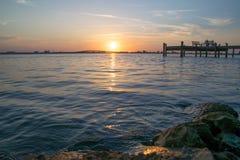 Muelle de la puesta del sol Fotos de archivo libres de regalías