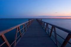 Muelle de la puesta del sol Imagen de archivo libre de regalías