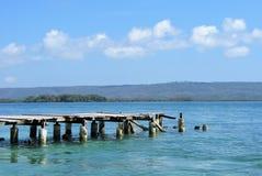 Muelle de madera en la playa Fotografía de archivo libre de regalías