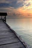 Muelle del barco en puesta del sol Foto de archivo libre de regalías