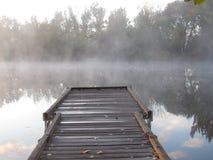 Muelle en el lago de la salida del sol Imagenes de archivo