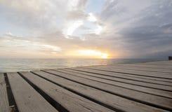 Muelle en la puesta del sol Fotos de archivo libres de regalías