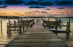 Muelle en la puesta del sol Foto de archivo libre de regalías