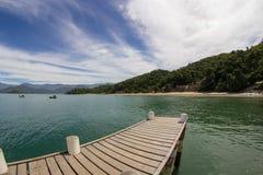 Muelle, océano y barcos fotografía de archivo libre de regalías