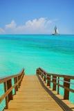 Muelle y barco de vela Imágenes de archivo libres de regalías