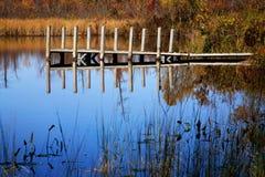 Muelle y charca, Michigan del barco Foto de archivo
