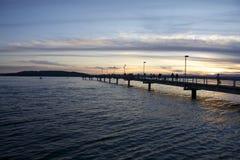 Muelles en la puesta del sol Imagenes de archivo