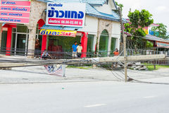 MUENG, PHUKET/THAILAND AUG 2015: Traffic turbulence caused by electricity pole damage on street due to heavy rain disaster on AUG1 Royalty Free Stock Images