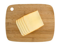 Muenster cheese slices on a wood cutting board Royalty Free Stock Photos