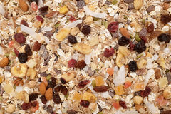 Muesli background - mixed fruit and nuts with cereal flakes stock photos