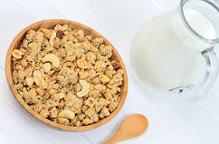 Muesli in a bamboo bowl with milk Stock Photo