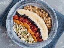 Muesli with banana, blueberries, dried apricots stock images