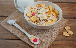Muesli with bananas and candy hearts. Royalty Free Stock Images
