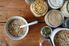 Muesli bar and bowl of oatmeal royalty free stock photo