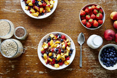 Muesli bar fresh organic fruits and cereal in a bowl on dark wooden table stock image