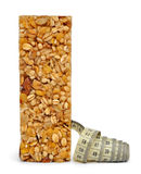 Muesli Bar with measuring tape. Isolated on white background royalty free stock photography