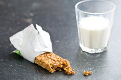Muesli bar and milk. On kitchen table Royalty Free Stock Photography