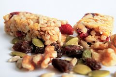 Muesli bar with nuts on the table. Image of muesli bar with and apple nuts on a table Royalty Free Stock Photography
