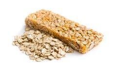 Muesli bar and oat flakes Stock Photography