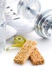 Muesli bar and sport equipment Stock Photo