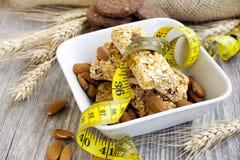 Muesli bars and almonds,diet concept Stock Photo