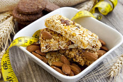 Muesli bars and almonds,diet concept Royalty Free Stock Photos