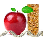 Muesli Bars with apple and measuring tape Royalty Free Stock Photos