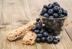 Muesli Bars with Blueberries in a glass Stock Images