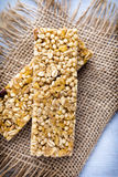 Muesli bars, cereal bars on the wooden background. Stock Photo