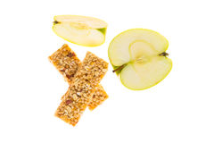 Muesli bars dried fruit on isolated background with apple. Muesli bars with dried fruit on isolated background with apple royalty free stock images