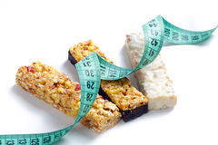 Muesli bars with measuring tape Stock Images