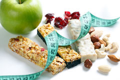 Muesli bars with measuring tape Stock Photos