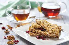 Muesli Bars. On plate with nuts and dried fruits Stock Photo