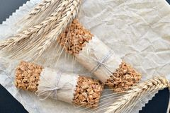 Muesli bars with wheatear. Two muesli bars with wheatear on backing parchment background Stock Photo