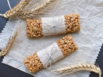 Muesli bars with wheatear. Two muesli bars with wheatear on backing parchment background, top view Royalty Free Stock Images