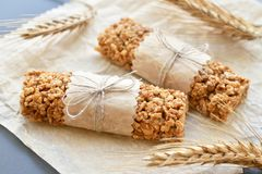 Muesli bars with wheatear. Two muesli bars in paper wrapper with wheatear on backing parchment background Stock Photography