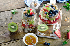 Muesli and berries for healthy breakfast on a rustic wooden back Stock Photos