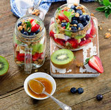 Muesli and berries for healthy breakfast on rustic wooden backgr Stock Photography