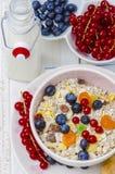 Muesli with berries and milk Stock Image