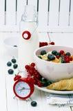 muesli with berries and milk stock photo