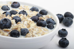 Muesli with Blueberries. Close-up of muesli with milk and topped with blueberries Stock Photography